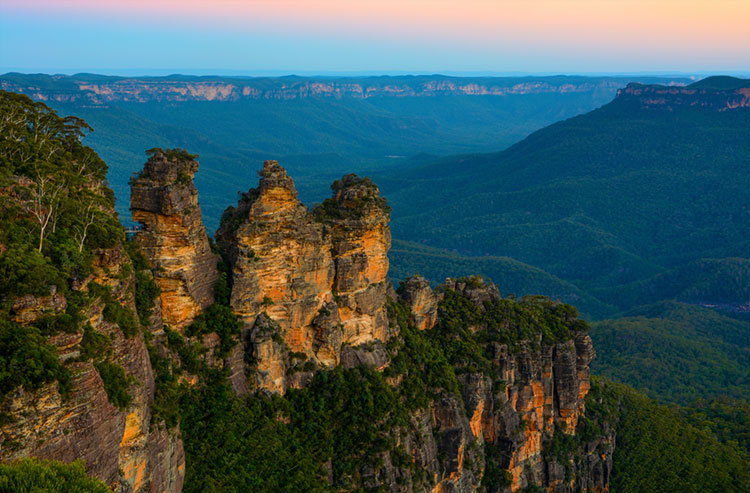 Unique rock landmark known as the Three Sisters in Australia's Blue Mountains.