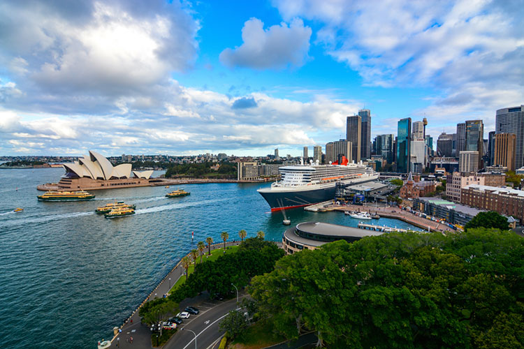 Wide view of Sydney Harbour, Circular Quay, and the Opera House.
