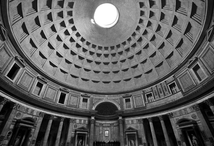 Black and white of the impressive interior of the Roman Pantheon.