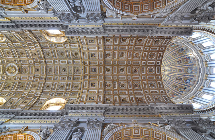 Dome interior and ornate ceiling of the nave in St. Peter's Basilica.